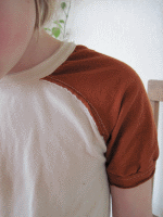 Child wearing a raglan sleeve shirt